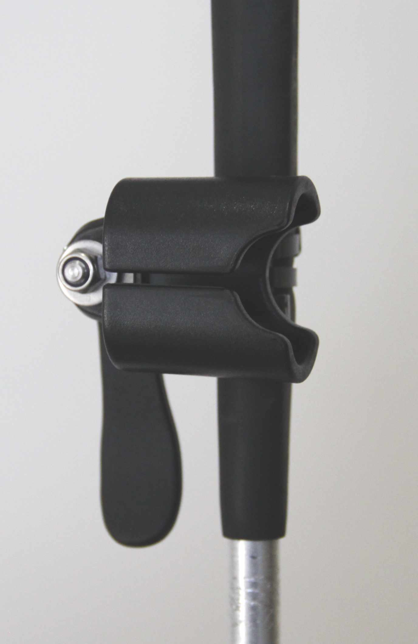 Holder attached to the rubber handle of a cane